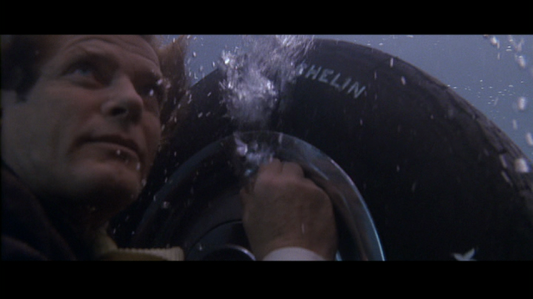 A-View-to-a-Kill-James-Bond-Roger-Moore-underwater-tire-air.png