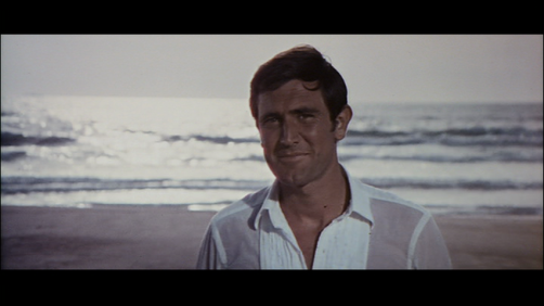 On-Her-Majestys-Secret-Service-James-Bond-George-Lazenby-beach.png